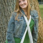 High school senior next to a tree in the park by Dan Iott Photography