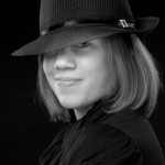 Black and White of senior in her cool hat by Dan Iott Photography